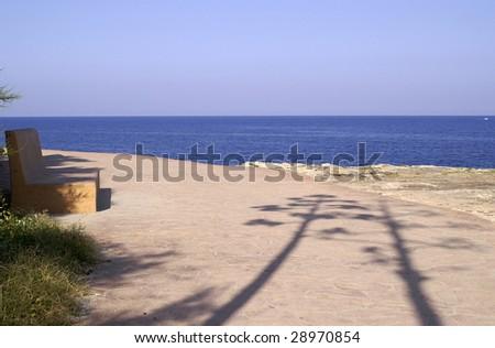 bench by the sea, Majorca, Spain - stock photo