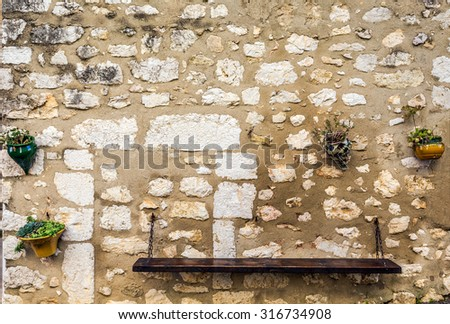 Bench for rest on the wall - stock photo