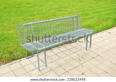 bench in a park with grass