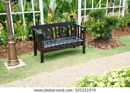 Bench in a peaceful garden - stock photo