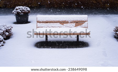Bench in a snow night - stock photo