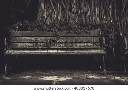 Bench in low light - stock photo