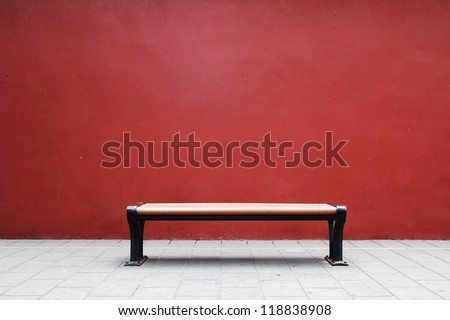 Bench in The Forbidden City with red wall