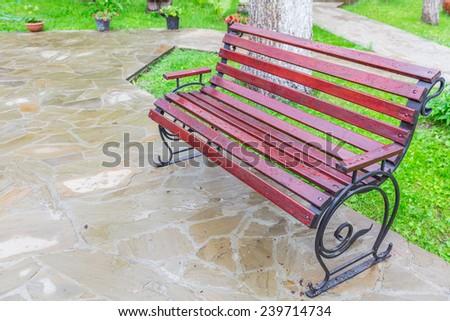 bench in the park in spring - stock photo