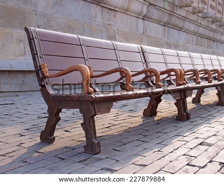 bench in the park. Shallow depth of field - stock photo