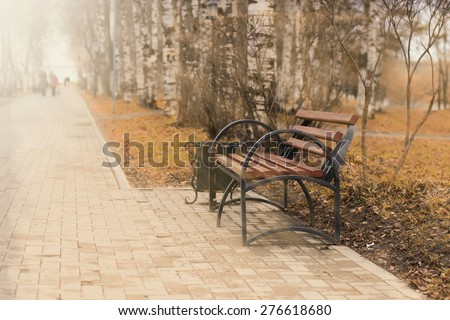 bench in the park the sun's rays - stock photo
