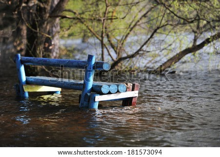 Bench in the period of a high water - stock photo