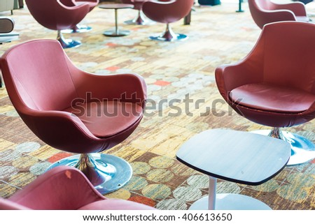 Bench in the terminal of airport. empty airport terminal waiting area with chairs, Departure lounge at the airport. - stock photo