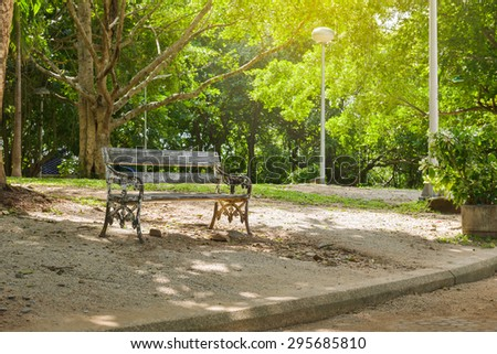 bench is in a morning green park - stock photo