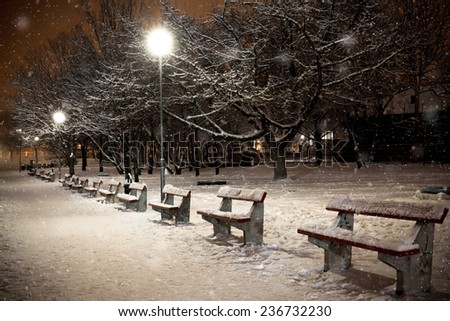bench lamp in light, winter evening in a park - stock photo