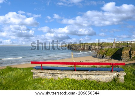 bench on a cliff edge  with views of Ballybunion beach cliffs and castle - stock photo
