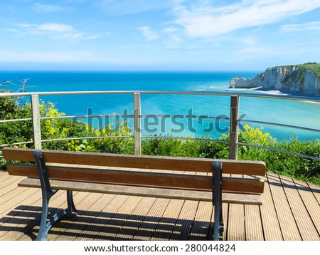 Bench on the cliffs of Etretat, France. Selective focus