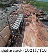 Bench on the rocks on Aland islands - Finland - stock photo