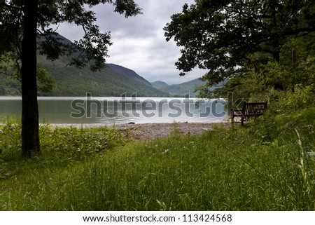 bench overlooking buttermere lake in the lake district, cumbria, england - stock photo