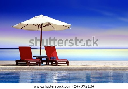 Bench seat at swimming pool - stock photo