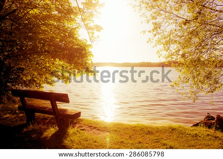 Bench with View in the Evening Sun - stock photo