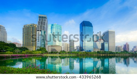 Benchakitti Park near the skyscraper business district,Bangkok city with park at twilght with reflection of skyline, Bangkok,Thailand - stock photo