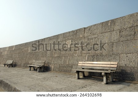 Benches on Cobb harbour wall in Lyme Regis, Dorset - stock photo