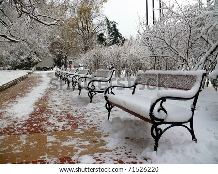Benches with snow in Sofia, Bulgaria - stock photo