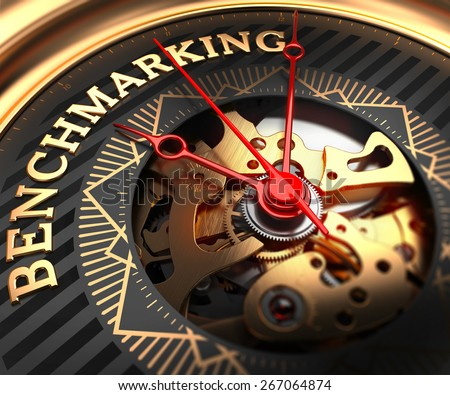 Benchmarking on Black-Golden Watch Face with Closeup View of Watch Mechanism.  - stock photo