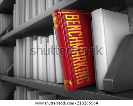 Benchmarking - Red Book on the Black Bookshelf between white ones. Internet  Concept. - stock photo