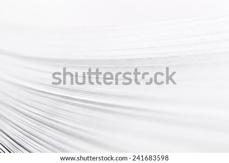 bending stack of paper, a fragment of a book or magazine - stock photo