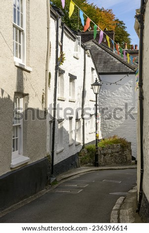bending street at Fowey, Cornwall, view of bending street with old houses in the village on southern coast of Cornwall