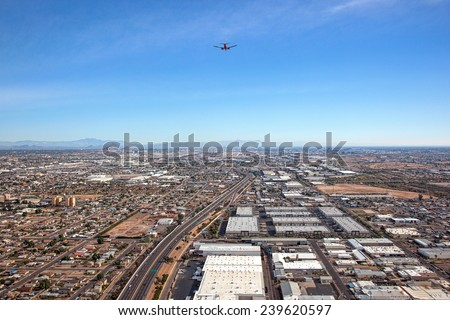 Beneath a commercial jet airliner on it's approach to Sky Harbor International Airport in Phoenix, Arizona