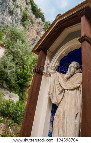 Benedictine blocks the mountain falling on the monastery - stock photo
