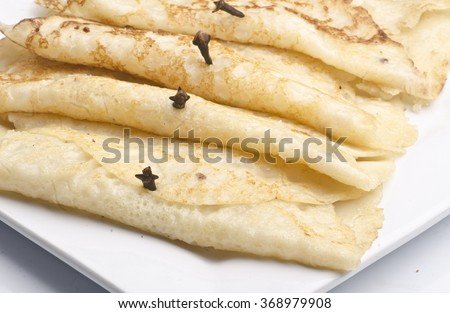 Bengali Treat- Pan Cake with Coconut Filling named as the Patishapta Pitha - stock photo