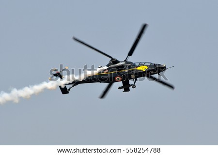 BENGALURU, INDIA - FEBRUARY 9, 2013: HAL Light Combat Helicopter of the Indian Air Force on display at Aero India 2013. Aero India is a biennial air show and aviation exhibition.