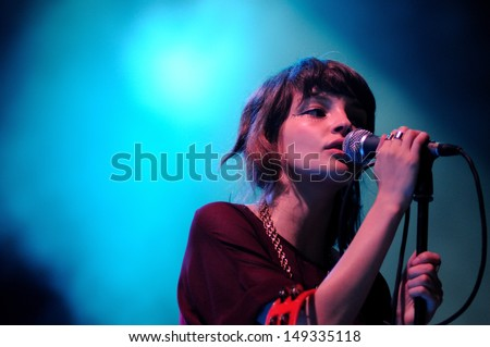 BENICASIM, SPAIN - JULY 21: Chvrches band concert performance at FIB (Festival Internacional de Benicassim) 2013 Festival on July  21, 2013 in Benicasim, Spain. - stock photo