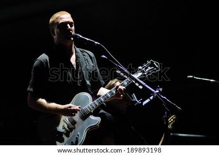 BENICASIM, SPAIN - JULY 18: Queens of the Stone Age (American rock band from Palm Desert, California) concert at FIB 2013 Festival on July 18, 2013 in Benicasim, Spain. - stock photo