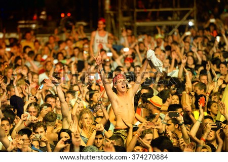 BENICASSIM, SPAIN - JUL 20: Crowd in a concert at FIB Festival on July 20, 2014 in Benicassim, Spain.