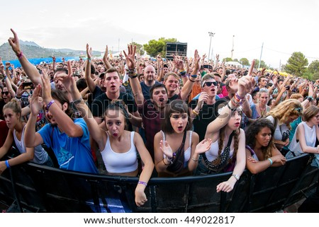 BENICASSIM, SPAIN - JUL 19: Crowd in a concert at FIB Festival on July 19, 2015 in Benicassim, Spain.