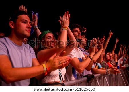 BENICASSIM, SPAIN - JUL 15: The crowd in a concert at FIB Festival on July 15, 2016 in Benicassim, Spain.