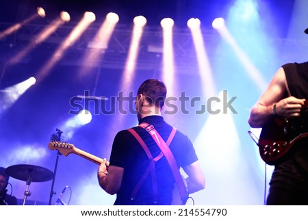 BENICASSIM, SPAIN - JULY 18: Albert Hammond, Jr. (musician and guitarist of the indie rock band The Strokes) performs at FIB Festival on July 18, 2014 in Benicassim, Spain. - stock photo