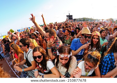 BENICASSIM, SPAIN - JULY 20: Crowd in a concert at FIB Festival on July 20, 2014 in Benicassim, Spain.