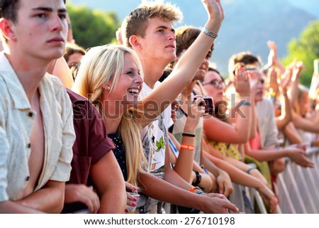 BENICASSIM, SPAIN - JULY 20: Crowd in a concert at FIB Festival on July 20, 2014 in Benicassim, Spain. - stock photo