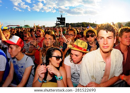 BENICASSIM, SPAIN - JULY 20: Crowd in a daylight concert at FIB Festival on July 20, 2014 in Benicassim, Spain.