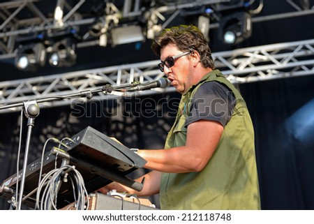 BENICASSIM, SPAIN - JULY 18: Keyboard player and singer of Los Claveles (band) performs with a Joy Division shirt at FIB Festival on July 18, 2014 in Benicassim, Spain.