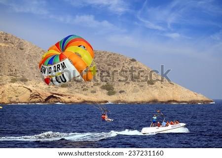 BENIDORM, SPAIN - AUGUST 16: The amazing sport para sailing made around of Poniente Beach, Spain; on august 16, 2014 in Benidorm.  - stock photo