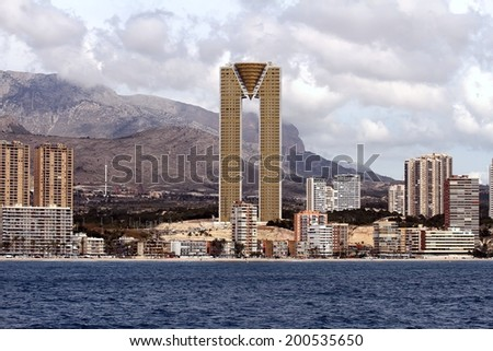 """BENIDORM, SPAIN � MARCH 16: The """"Intempo"""" towers, of 200 meters and 47 floors, rise majestic in the landscape of Poniente Beach, Spain; on march 16, 2014 in Benidorm.  - stock photo"""