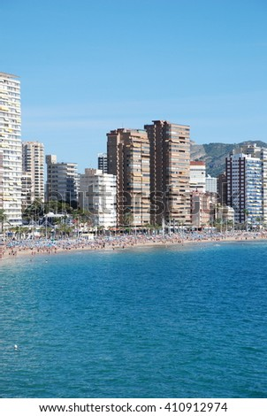 BENIDORM, SPAIN - NOVEMBER 4: Crowed beaches of Benidorm November 4, 2010 in Benidorm, Spain. Crowed beaches with a lot of tourists with a lot of hotels on the background  - stock photo