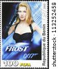 "BENIN - CIRCA 2003: A postage stamp printed by Benin shows British actress Rosamund Pike as Miranda Frost in the film ""Die Another Day"", circa 2003 - stock photo"