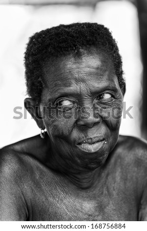 BENIN, MARCH 8, 2012: Unidentified Beninese old woman smiles for the camera in Benin, Mar 8, 2012. People of Benin suffer of poverty due to the unstable economical situation