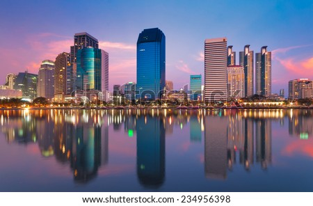 Benjakiti park city downtown skyline at night with water reflection, Bangkok,Thailand  - stock photo