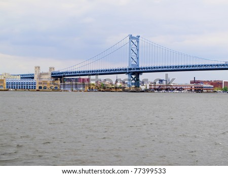 Benjamin Franklin Bridge as seen from the New Jersey side of the Delaware River with Philadelphia, Pennsylvania in the background. - stock photo