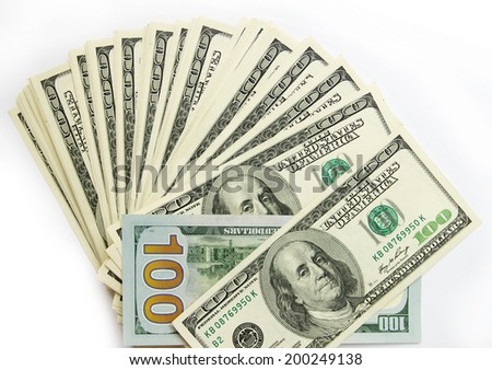 Benjamin Franklin 100 dollar bills arranged randomly with the portrait facing uppermost in a closeup conceptual financial and monetary background - stock photo