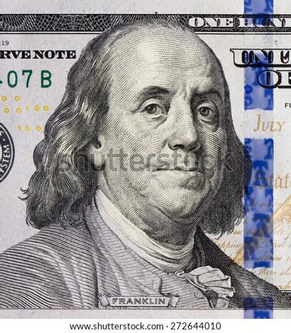 Benjamin Franklin portrait on one hundred dollars banknote - stock photo